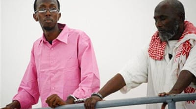 Abdiaziz Abdinuur Ibrahim (left) was sentenced to jail after interviewing an alleged rape victim [AFP/Getty Images]