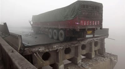 The explosion caused several vehicles to crash off the bridge in Mianchi County [Reuters]