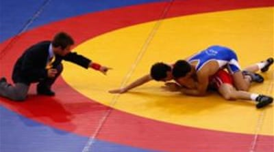 Wrestling doesn't need a special climate - no snow necessary, no water needed, no mountains [AP]