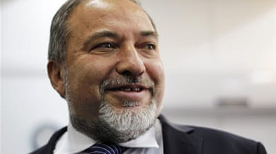 Avignor Lieberman denies charges of fraud and breach of trust, allegations that prompted his resignation [Reuters]