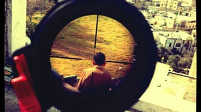Mor Ostrovski's photo shows what appears to be a Palestinian boy in the crosshairs of a rifle [Instagram]