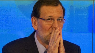 Many Spaniards have called for Prime Minister Rajoy's resignation over the corruption scandal [AFP]