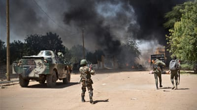 In pictures: Street battle in Mali