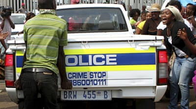 S Africa police hit by 'dragging video'