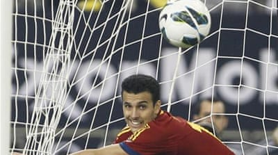Pedro Rodriguez follows the ball into the net after scoring against Uruguay [Reuters]