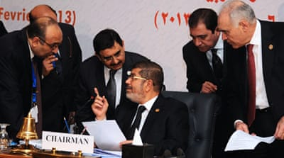 President Mohamed Morsi urges OIC members to support the Syrian opposition's efforts [Reuters]