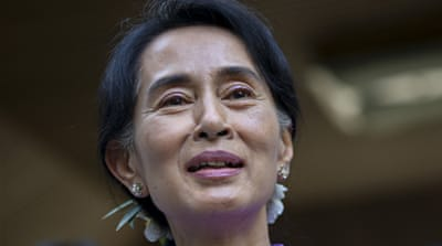 Suu Kyi urged the opposition party 'to seize the chance' as it prepares for elections in 2015 [AFP]