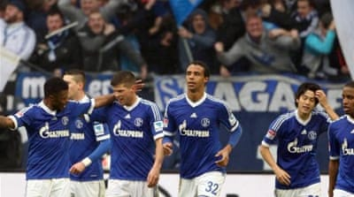 Schalke players celebrate their 2-1 victory over rivals Borussia Dortmund on Saturday [EPA]