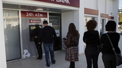Bailout terms prompt run on Cyprus banks