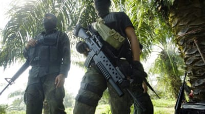 Malaysian security forces have been attempting to rid Sabah invaders who remain on Borneo [Reuters]
