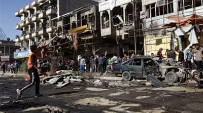 Series of bomb blasts kill scores in Baghdad