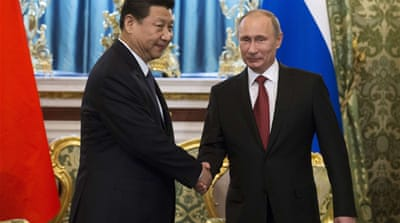 China's Xi bolsters Russia ties on first trip