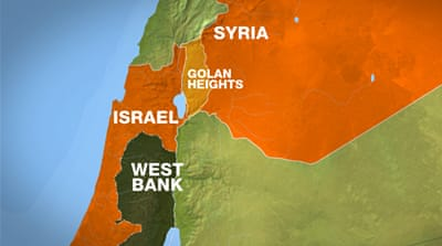 Israel is reinforcing its border fence and has stepped up military patrols in the occupied Golan Heights [Reuters]