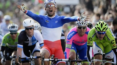 Heads down: Bouhanni won the opening stage from Saint-Germain-en-Laye to Nemours in a sprint finish [AFP]
