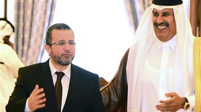 Sheikh Hamad, at right, made the aid announcement jointly with Qandil, left, in Doha on Wednesday [Reuters]