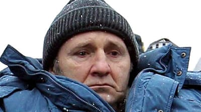 Russia buries beaten journalist
