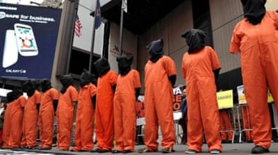 The US must close the Guantanamo facility and move the trials to federal courts, writes Worthington [AP]