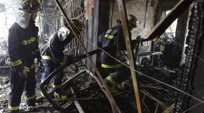 Firefighters said the fire started in an internet cafe on the floor below the hotel in a five-story building [Reuters]