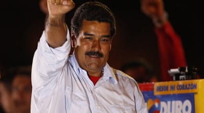 Nicolas Maduro, a protege of former Venezuelan President Hugo Chavez, narrowly won election on Sunday [Reuters]