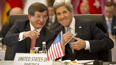 "Kerry (R) and Turkish Foreign Minister Ahmet Davutoglu (L) attend ""Friends of Syria"" meeting in Istanbul [EPA]"