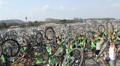 Tens of thousands of cyclists ride along Budapest's Danube River on Saturday [Kristina Jovanovski/Al Jazeera]
