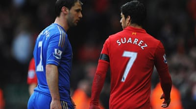 Suarez dug his teeth into Chelsea defender Branislav Ivanovic during Sunday's English Premier League match [AFP]