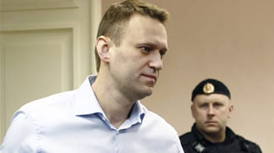 Alexei Navalny accused of heading a group that embezzled $500,000 in timber from state-owned firm[Reuters]