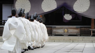 Japanese lawmakers follow a Shinto priest to pay their respects at the controversial Yasukuni Shrine in Tokyo [AFP]