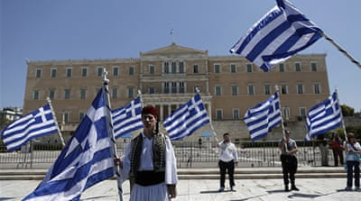 Greece parliament approves job cuts
