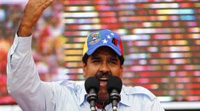Maduro, centred, told his supporters he was committed to building 'socialism to its last consequences' [Reuters]