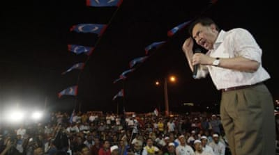 Opposition leader Anwar Ibrahim speaks to his supporters after prayer at his house in Kuala Lumpur [Reuters]
