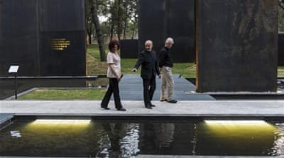Some victims' families protested the unveiling of the memorial saying they wanted justice instead [AP]