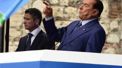 Scandal-tainted Berlusconi's political comeback in earlier polls is overshadowed by battles with prosecutors [AFP]
