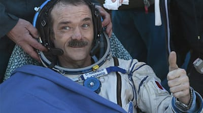 Canadian astronaut returns to Earth a star