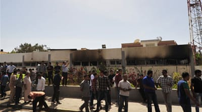 Police said the building housing the police was set on fire in another attack on Wednesday [Reuters]