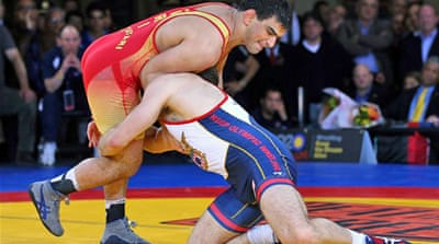 Global rivals unite to save Olympic wrestling