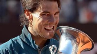 Spain's Rafael Nadal won 6-1, 6-3 against Federer in the final of the Italian Open tennis tournament in Rome [AFP]