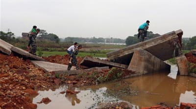 Over 150 homes collapsed in the flood water as the torrential rains continue to pound the region [AFP]