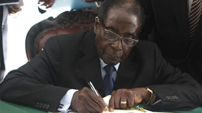 Zimbabwe's Mugabe signs new constitution