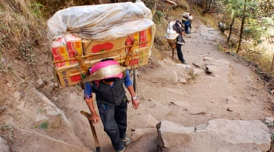 In pictures: Nepal porters' heavy burden