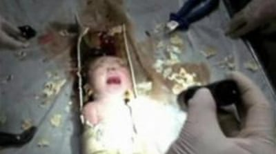 China rescuers save newborn from sewer pipe