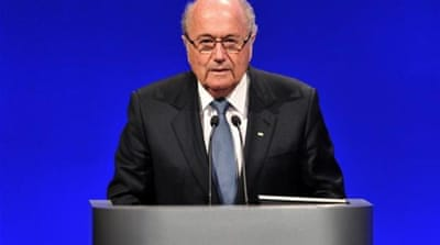 FIFA President Sepp Blatter (R) is touring West Bank to talk about football in the region [AP]