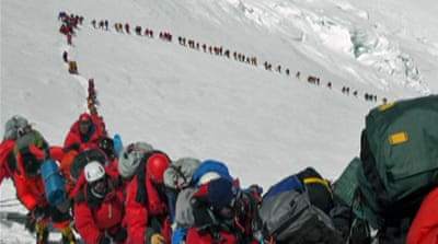 Race to climb Everest stirs tension