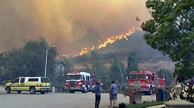 Wildfires sweep through southern California