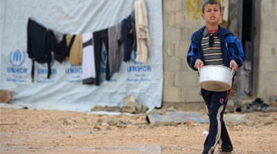 Young Syrian refugees fetch water in the Za'atari refugee camp in Jordan last February [Getty Images]