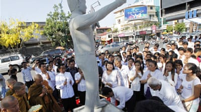Statue of Chea Vichea stands across the street from where he was gunned down in broad daylight in 2004 [EPA]
