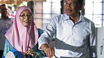 Anwar Ibrahim (right) has accused the Election Commission of being 'complicit' in opposition's defeat [Reuters]