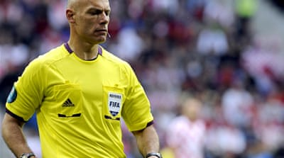 World Cup 2010 finals referee Webb said off-pitch officials could ease the pressure on referees who could not always spot racist incidents [EPA]