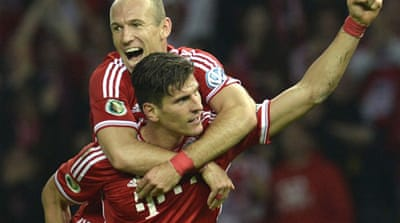 Bayern became the first German team to win the treble after their 3-2 win against VfB Stuttgart [AFP]