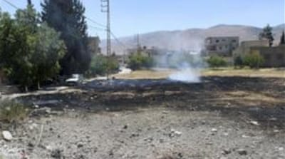 One of the rockets fired from Syria caused the outbreak of a fire in an orchard in Hermel [Reuters]